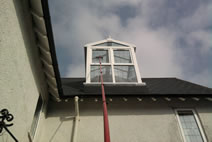 Cleaning a 2nd floor attic dormer window