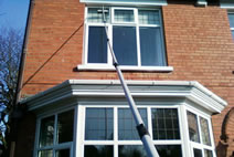 Cleaning a 1st floor window over a bay using a waterfed pole