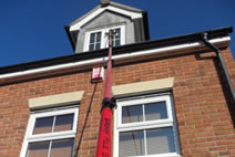 Using a waterfed pole to clean a 2nd floor attic dormer